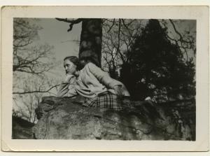 Sandra Maynard on a rock at the Mary Washington Monument