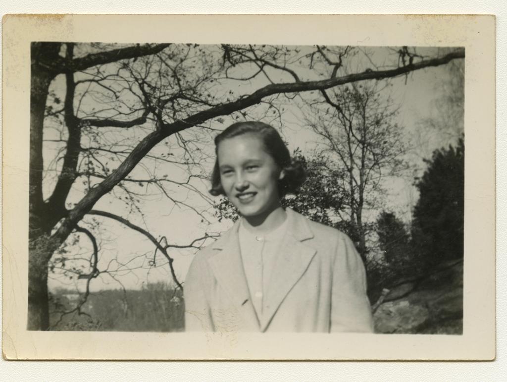 Black and white polaroid of family friend Sandra Maynard outside
