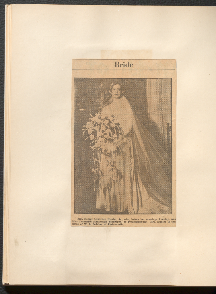 "A black and white photo of Jeanette Stoffregen in her wedding dress and veil holding a bouquet, titled ""Bride"""