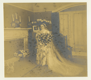 Katherine Stoffregen in her wedding dress and veil with a bouquet